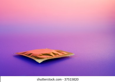 Yellow condom on color background