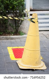 Yellow cone surrounding building entrance and stairs