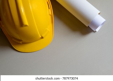 Yellow construction cap and paper roll