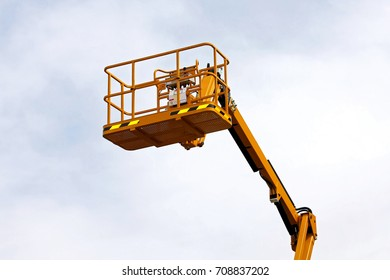 Yellow construction platform bucket for high works