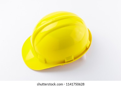 Yellow construction safety hard hat isolated on a white background