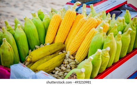 yellow corn and groundnut on the cart