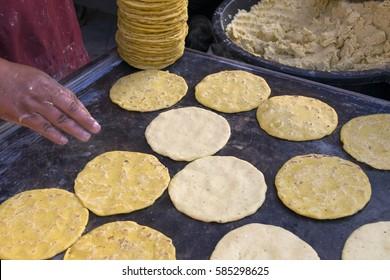 Yellow corn tortillas in comal or hot iron handmade