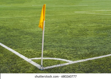 Yellow corner flag on the football field