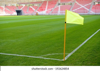 Yellow corner flag on an soccer field