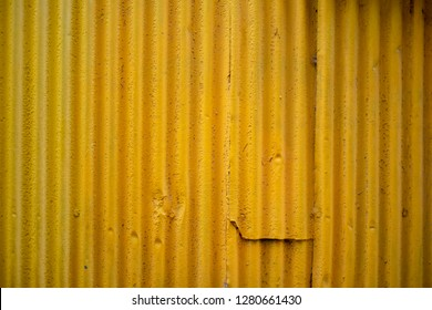 Yellow corrugated metal zinc wall for background or texture