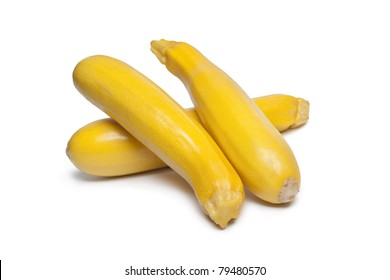 Yellow courgettes on white background