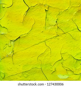 Yellow cracked paint texture for background usage