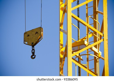 Yellow Crane against Blue Sky , tower with hook