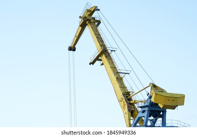 Yellow crane in cargo port translating coal. Industrial scene - Shutterstock ID 1845949336