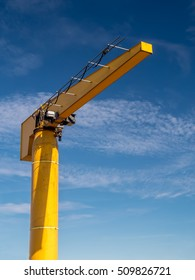 Yellow crane at the harbour shot against the sky