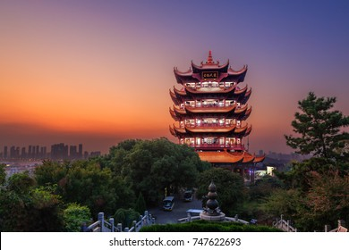 """Yellow Crane Tower at twilight, the traditional Chinese multi-storey tower located on Sheshan (Snake Hill) in Wuhan, Hubei, China, 4 Chinese letters on tower is """"Mu Ji Tian Chu"""" means """"amazing heaven"""""""