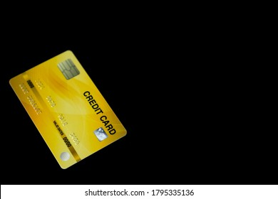 yellow credit card on black background for online shopping, payment e-commerce, internet banking or spending money concept.