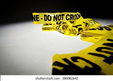 Yellow crime scene 'Do not cross' tape