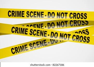 Yellow crime scene tape on white background