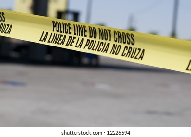 Yellow crime scene tape surrounds gas station