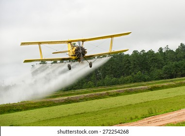 yellow crop dusting plane biplane spray