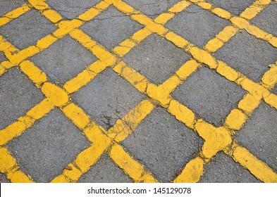 Yellow cross on road