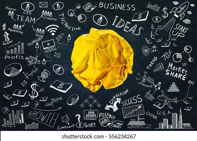 Yellow crumpled paper ball with business doodles set.ideas concept