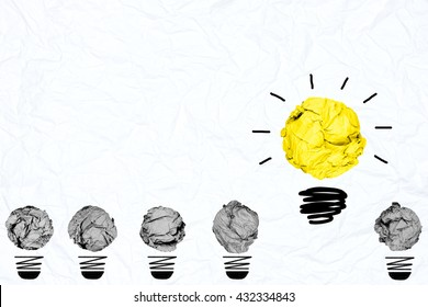 yellow crumpled paper light bulb with blue white paper background creative inspiration concept metaphor for think different idea /another direction /do other way