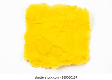 Yellow crumpled paper on white background