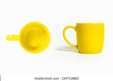 Yellow cup of coffee isolated on white background.