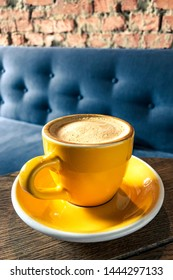 Yellow cup with coffee and vintage background