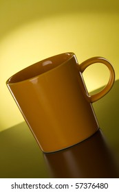 Yellow cup on a yellow gradient background