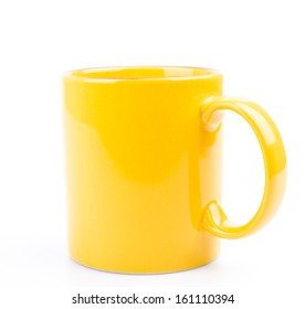 Yellow cup on white background