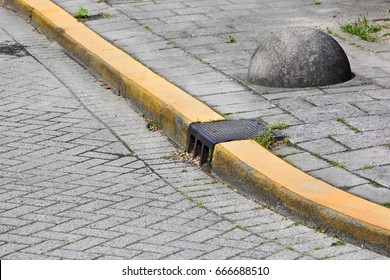 Yellow curb and obstacle on a street corner in the Netherlands
