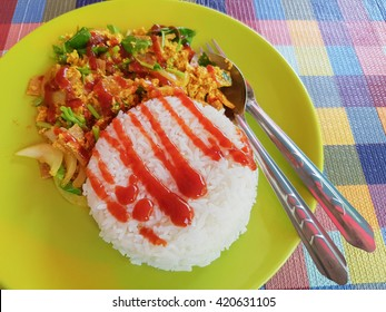 Yellow curry pork with rice and tomato sauce