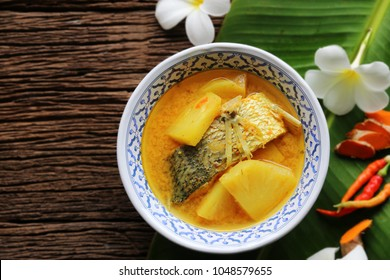 Yellow curry snapper fish with pineapple , thai food and vegetable in white dish / selective focus and top view image