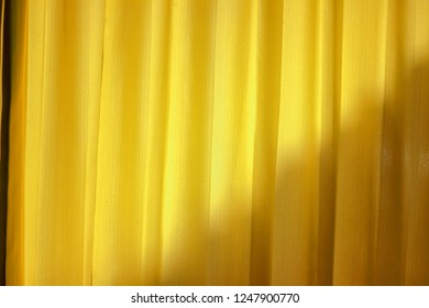 Yellow curtains with light on the back make the blinds.