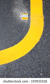 yellow curve on the road.