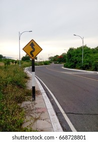 yellow curve sign on road