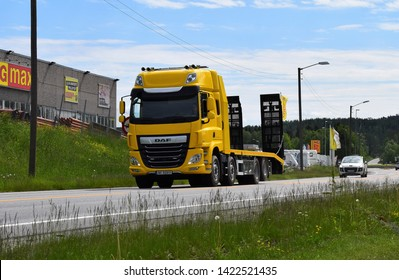 Yellow DAF truck vehicle on the highway in sunny and summer season - Kongsvinger, Norway (6th june 2019)