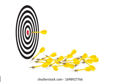 Yellow dart hit the red bulleye and  some missing the target lay on the white space near the targer bacground, Naver give up, Winner take all and Keep trying for success Idea concept