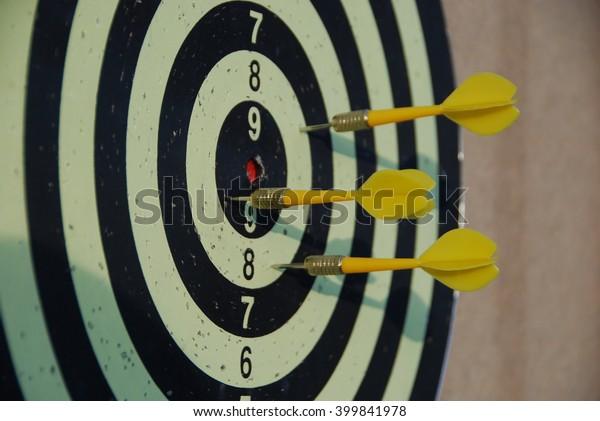 Yellow darts missing target