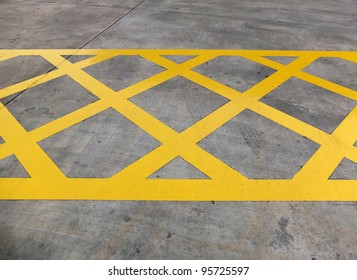 Yellow diagonal hazard stripes