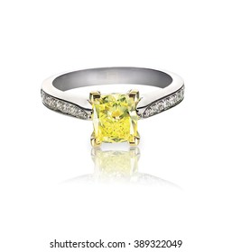 yellow diamond colored engagement ring isolated on white