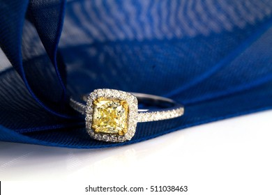 Yellow diamond ring ribbon background