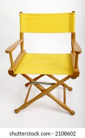 Yellow director's chair against a white background