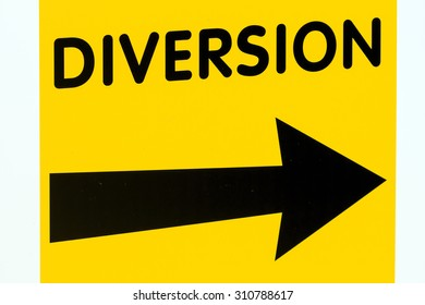 Yellow diversion sign board with black Right pointing arrow