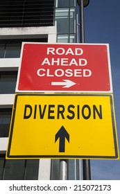 Yellow Diversion Sign in Urban Setting