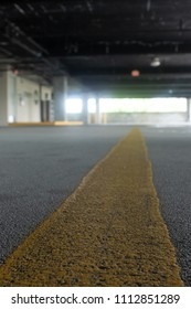 Yellow dividing line on the road in a parking garage