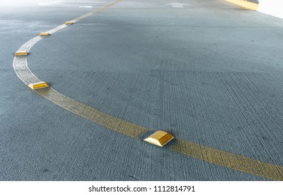 Yellow dividing line with a reflector on a road