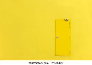 yellow door on yellow wall