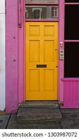 Yellow Door With Pink Doorway in Portobello London