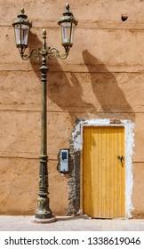 Yellow door and street lamp in the Medina of Marrakech, Morocco