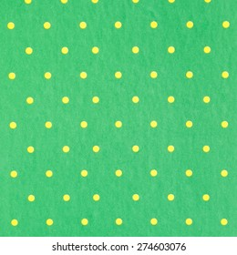 Yellow dot with green background paper texture